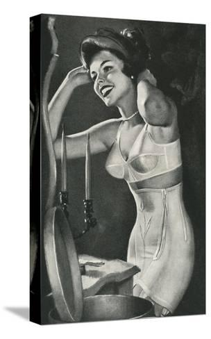 Lady in Underwear Trying on Hat--Stretched Canvas Print