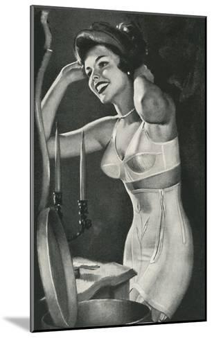 Lady in Underwear Trying on Hat--Mounted Art Print