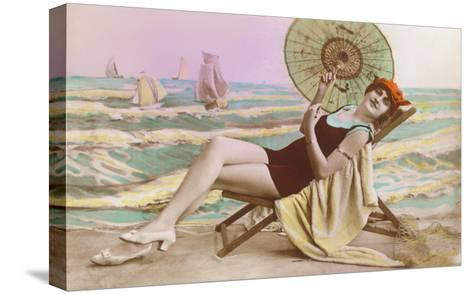 Woman in Beach Chair with Parasol--Stretched Canvas Print