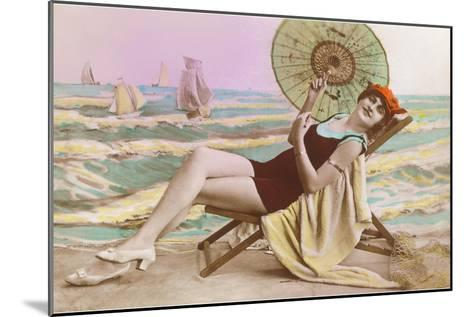 Woman in Beach Chair with Parasol--Mounted Art Print