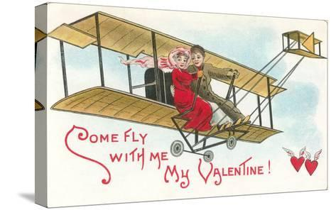 Come Fly with me, Couple in Vintage Biplane--Stretched Canvas Print