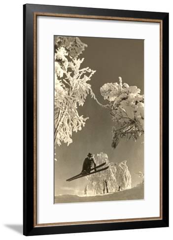 Airborne Skier Amid Frost-Laden Trees--Framed Art Print