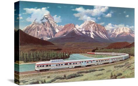 Train Passing through Rocky Mountains--Stretched Canvas Print