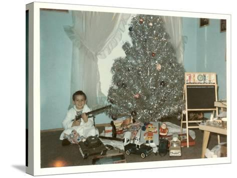 Boy with Gun and Fake Christmas Tree--Stretched Canvas Print