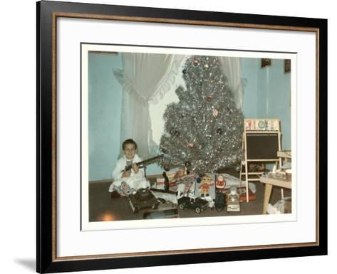 Boy with Gun and Fake Christmas Tree--Framed Art Print