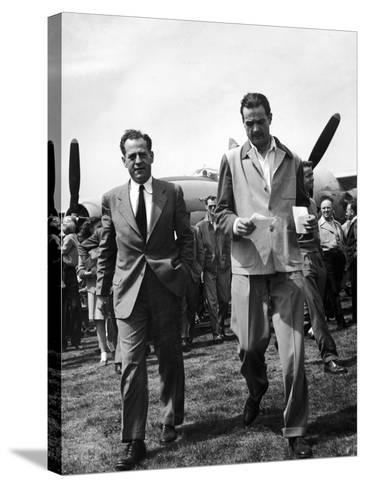 Howard Hughes Walks Towards Press Following Flight in the Hughes Xf-11 Reconnaissance Plane--Stretched Canvas Print