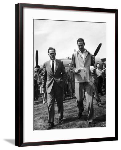 Howard Hughes Walks Towards Press Following Flight in the Hughes Xf-11 Reconnaissance Plane--Framed Art Print