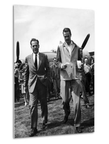 Howard Hughes Walks Towards Press Following Flight in the Hughes Xf-11 Reconnaissance Plane--Metal Print