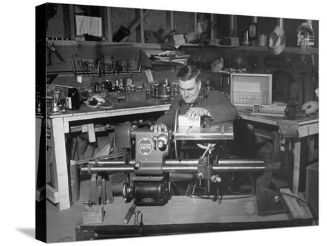 """A Man Using the New """"Shopsmith"""" a Multi-Purpose Power Tool for Carpentry Duties--Stretched Canvas Print"""