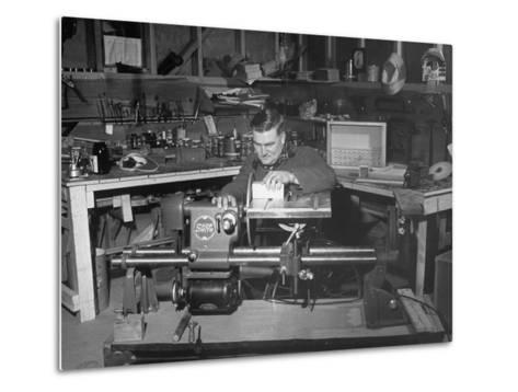 """A Man Using the New """"Shopsmith"""" a Multi-Purpose Power Tool for Carpentry Duties--Metal Print"""