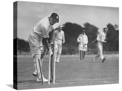 Men Setting Up Cricket Field--Stretched Canvas Print