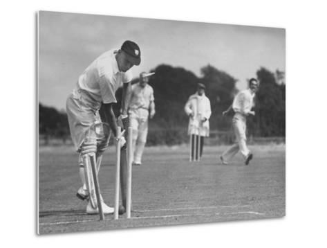 Men Setting Up Cricket Field--Metal Print
