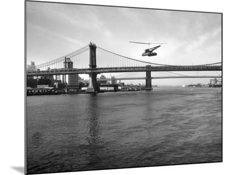 NYC Police Helicopter Hovering over the East River Next to the Manhattan Bridge--Mounted Photographic Print