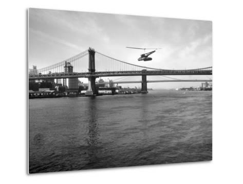 NYC Police Helicopter Hovering over the East River Next to the Manhattan Bridge--Metal Print
