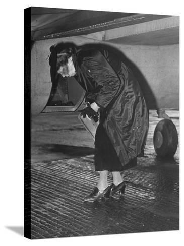 Eleanor Roosevelt Examining Rear Turret-Gunner's Compartment under the Tail Assembly of US Bomber--Stretched Canvas Print