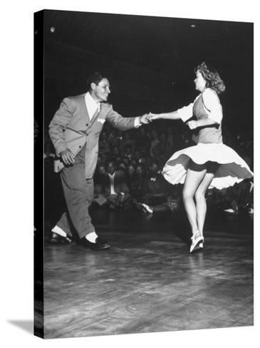 Couple Dancing in a Jitterbug Contest--Stretched Canvas Print