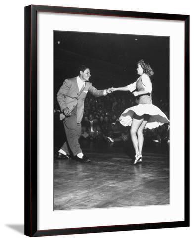 Couple Dancing in a Jitterbug Contest--Framed Art Print