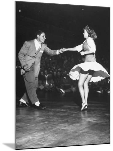 Couple Dancing in a Jitterbug Contest--Mounted Photographic Print
