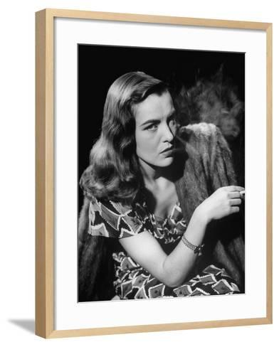 "Ella Raines Smoking a Cigarette in the Motion Picture ""Brute Force""--Framed Art Print"