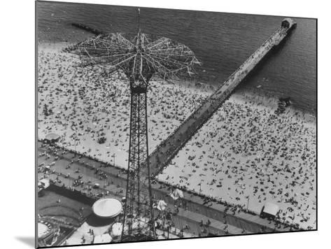 The Beach at Coney Island Looking Through Parachute Drop Tower at Crowded Beach--Mounted Photographic Print