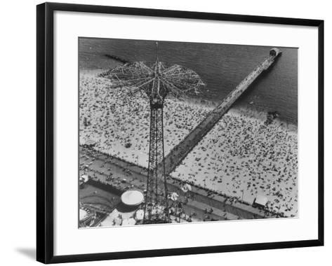 The Beach at Coney Island Looking Through Parachute Drop Tower at Crowded Beach--Framed Art Print