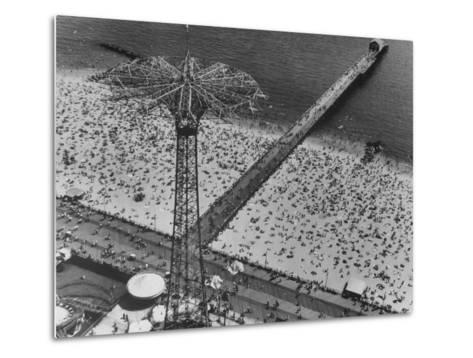 The Beach at Coney Island Looking Through Parachute Drop Tower at Crowded Beach--Metal Print