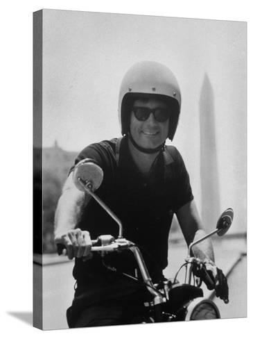 Peace Corps Director, Joseph H. Blatchford, Riding Motorcycle--Stretched Canvas Print