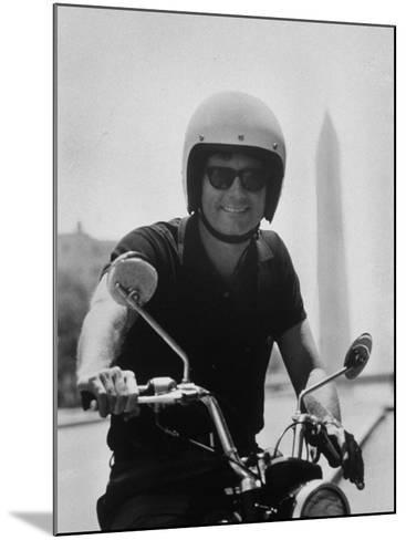 Peace Corps Director, Joseph H. Blatchford, Riding Motorcycle--Mounted Photographic Print