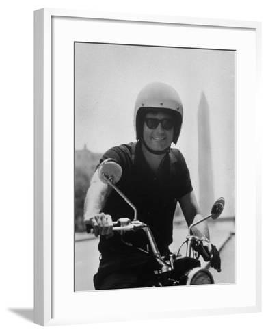 Peace Corps Director, Joseph H. Blatchford, Riding Motorcycle--Framed Art Print