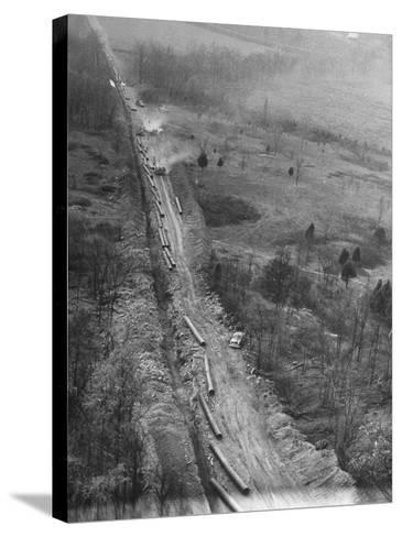 Gulf Interstate Gas Co. Laying Pipe to Be Used in Natural Gas Pipeline Stretching from LA to WV--Stretched Canvas Print