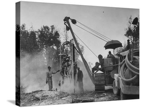 Workers From Gulf Interstate Gas Co. Laying Pipe to Be Used in Natural Gas Pipeline--Stretched Canvas Print