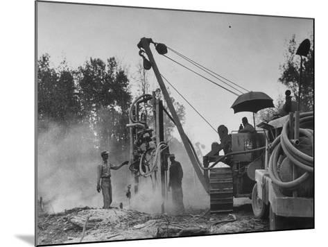 Workers From Gulf Interstate Gas Co. Laying Pipe to Be Used in Natural Gas Pipeline--Mounted Photographic Print