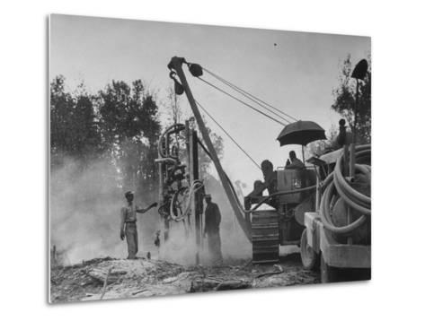 Workers From Gulf Interstate Gas Co. Laying Pipe to Be Used in Natural Gas Pipeline--Metal Print