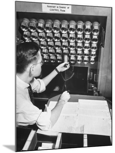 A Man Working in the Control Room in the Basement of the Library of Congress--Mounted Photographic Print