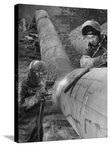 Workers Welding Pipeline to Be Used for Natural Gas--Stretched Canvas Print