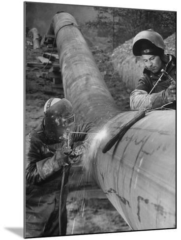 Workers Welding Pipeline to Be Used for Natural Gas--Mounted Photographic Print