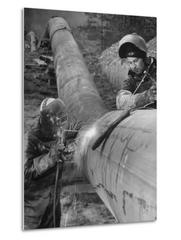 Workers Welding Pipeline to Be Used for Natural Gas--Metal Print