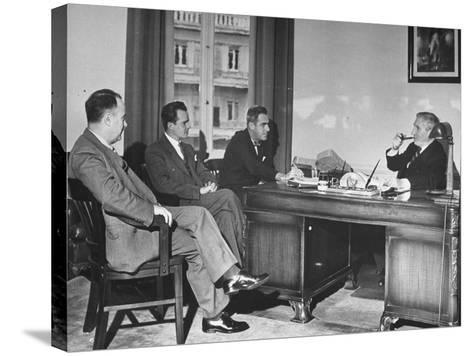 James H. Keeley, Oliver M. Marcy, Leonard J. Cromie and Lincoln Macveagh Having a Conference--Stretched Canvas Print