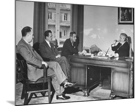 James H. Keeley, Oliver M. Marcy, Leonard J. Cromie and Lincoln Macveagh Having a Conference--Mounted Photographic Print