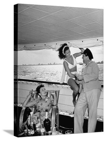 Miami Night Club Performers Future Fulton and Henry Dubbon Relaxing with Peggy Martin--Stretched Canvas Print