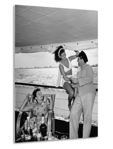 Miami Night Club Performers Future Fulton and Henry Dubbon Relaxing with Peggy Martin--Metal Print
