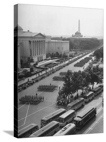Troops Marching in the Memorial Day Parade, the Smithsonian and Washington Monument in Background--Stretched Canvas Print