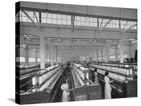 Women Working in the Spinning Room of Textile Mill--Stretched Canvas Print