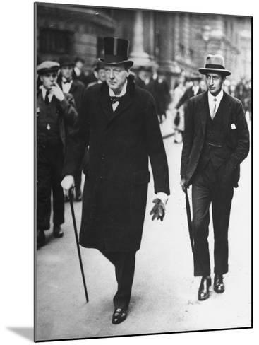 Sir Winston Churchill Walking in Street with Sir James Grigg, His Parliamentary Private Secretary--Mounted Photographic Print