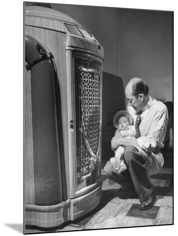 Bartender at the Sawteeth Club, Jack Wills with His Daughter Jane Listening to the Jukebox--Mounted Photographic Print