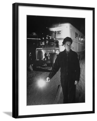 The Driver Placing a Flare on the Dark Road Where the Truck Is Stalled--Framed Art Print