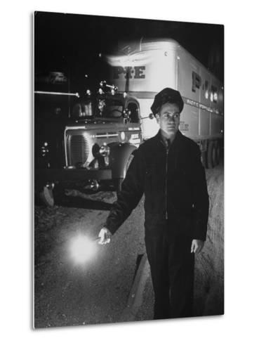 The Driver Placing a Flare on the Dark Road Where the Truck Is Stalled--Metal Print