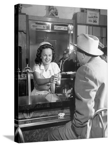 William O. Douglas's Daughter Serving Him a Soda at the Drugstore--Stretched Canvas Print