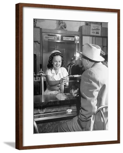 William O. Douglas's Daughter Serving Him a Soda at the Drugstore--Framed Art Print