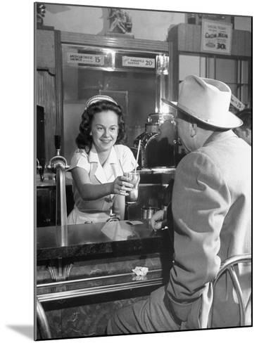 William O. Douglas's Daughter Serving Him a Soda at the Drugstore--Mounted Photographic Print